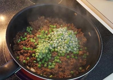 Adding frozen peas to cottage pie