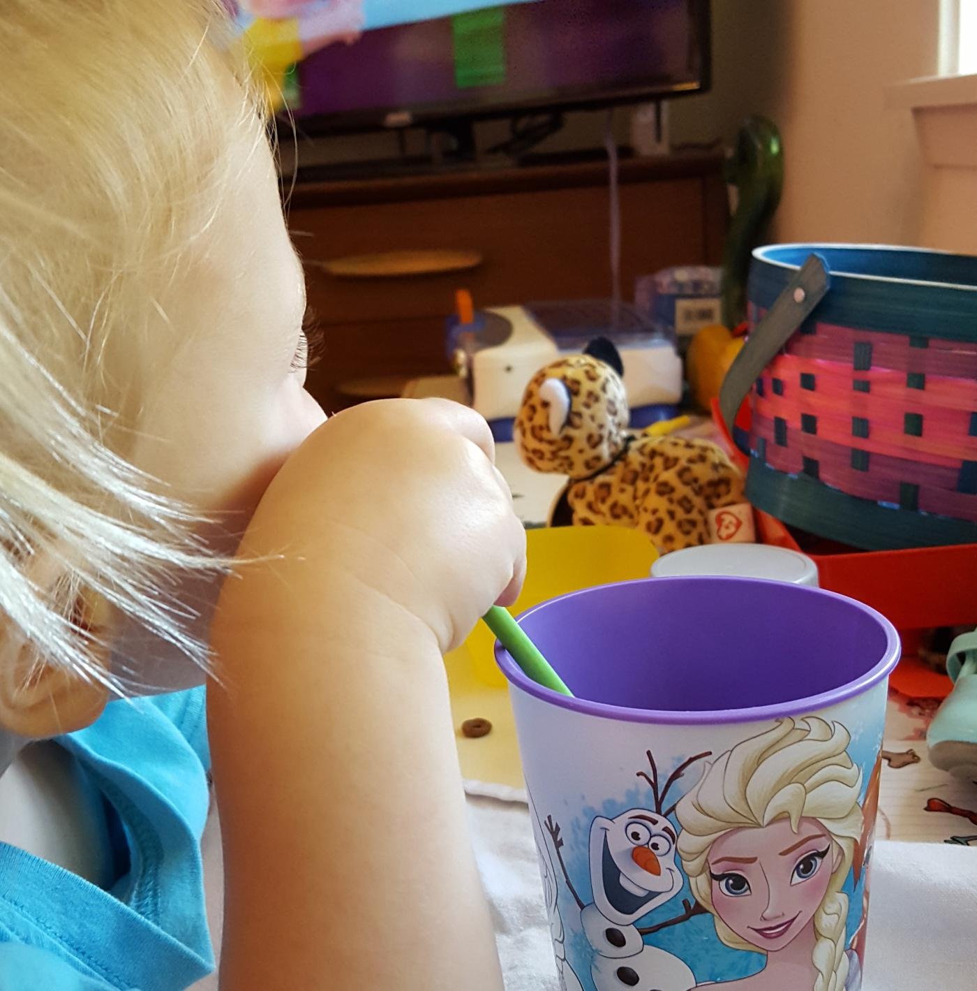 child drinking smoothie