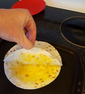 cooking quesadilla
