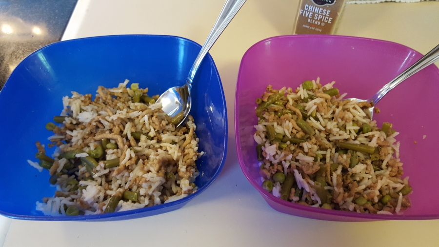 Kids portions of minced pork and green bean stir-fry