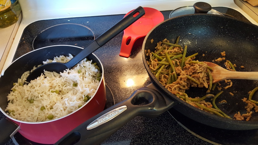 Rice and stir fry on the stove
