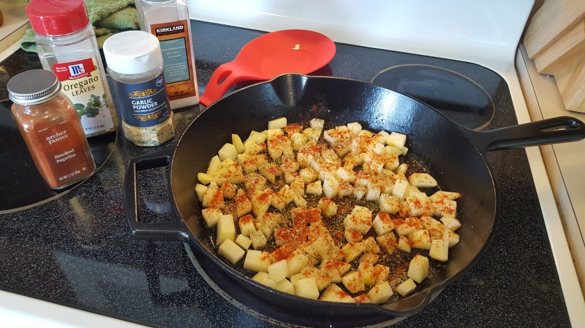 spices and potatoes in the frying pan