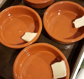 Butter to grease ramekins