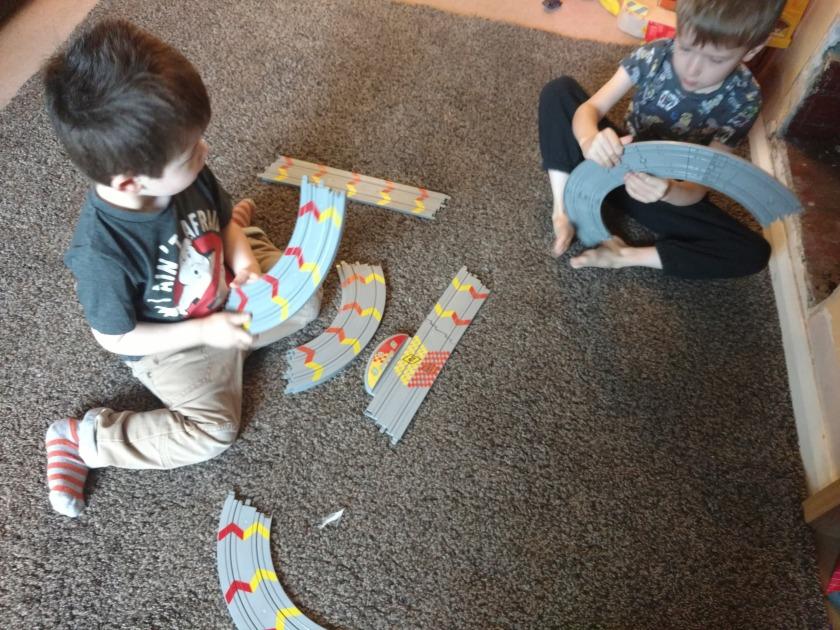 Kids assembling scalextric