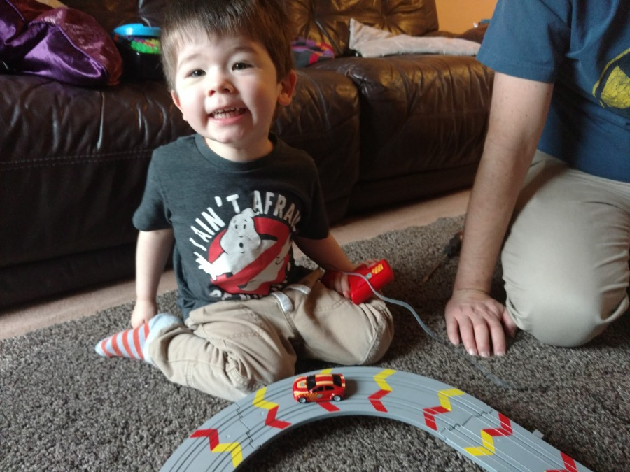 Child playing Scalextric